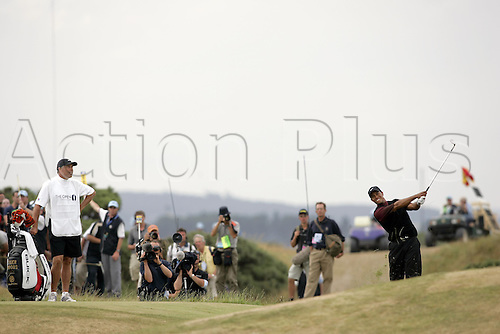 17 July 2005: American golfer Tiger Woods (USA) looks into the distance after playing an iron from the rough during the final round. Woods shot a 2 under par 70 to be 14 under and win the Open Championship, The Old Course at St Andrews, Scotland. Photo: Glyn Kirk/Actionplus...golf player 050717