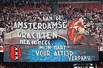 Nederland, Amsterdam, 30 maart 2014<br /> Eredivisie<br /> Seizoen 2013-2014<br /> Ajax-FC Twente<br /> Ajax-supporters (VAK410) ontrollen een spandoek met de tekst: ''Aan de Amsterdamse grachten heb ik heel mijn hart voor altijd verpand.''
