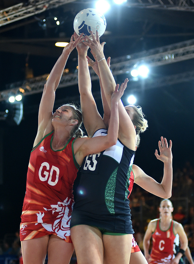 Wales' Ursula Pritchard and Northern Ireland's Lisa Somerville compete for a high ball<br /> <br /> Photographer Chris Vaughan/CameraSport<br /> <br /> 20th Commonwealth Games - Day 9 - Friday 1st August 2014 - Netball - SECC - Glasgow - UK<br /> <br /> © CameraSport - 43 Linden Ave. Countesthorpe. Leicester. England. LE8 5PG - Tel: +44 (0) 116 277 4147 - admin@camerasport.com - www.camerasport.com