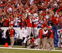 Ohio State Buckeyes defensive back Vonn Bell (11) celebrates his interception with Ohio State Buckeyes defensive back Cam Burrows (16) in the first quarter of the Big Ten Championship game at Lucas Oil Stadium in Indianapolis on Saturday, December 6, 2014. (Columbus Dispatch photo by Jonathan Quilter)