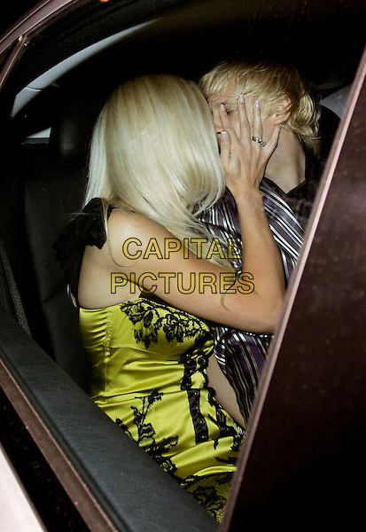 EMMA NOBLE & RICK PARFITT.The Laurent-Perrier Pink Party, Suka, Sanderson Hotel, London, England..April 25th, 2007.half length car kiss kissing couple .CAP/AH.©Adam Houghton/Capital Pictures