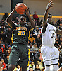 Rolgens Dextra #20 of Westbury, left, pulls down a rebound near Zion Stephens #31 of Baldwin during the Nassau County varsity boys basketball Class AA final at LIU Post on Saturday, Feb. 27, 2016. Baldwin went to halftime leading 35-18.