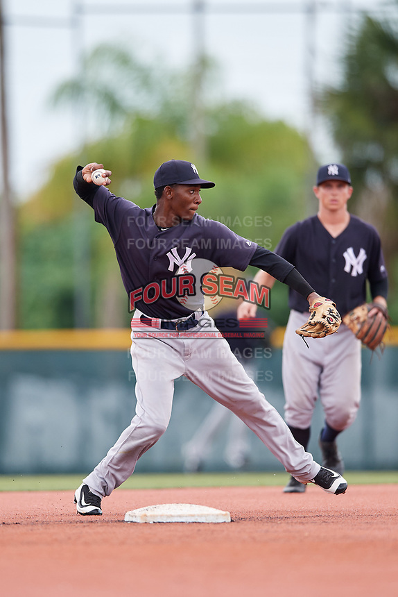 GCL Yankees East shortstop Brayan Jimenez (3) throws to first base during the second game of a doubleheader against the GCL Pirates on July 31, 2018 at Pirate City Complex in Bradenton, Florida.  GCL Pirates defeated GCL Yankees East 12-4.  (Mike Janes/Four Seam Images)