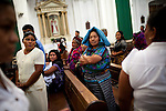 Churchgoers at the Church of San Francisco, in Antigua, Guatemala, on Saturday, July 30, 2011.