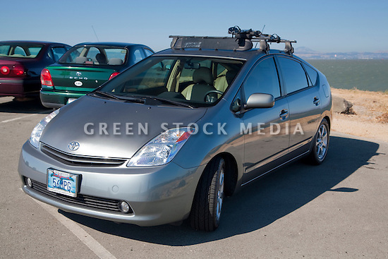 Kendrick Li's 2004 Toyota Prius has a '56 MPG' (56 miles per gallon) custom license plate. People pay for the customized plates and the proceeds support various causes. The fees collected for these Whale Tail License Plates support the California Coastal Commission environmental projects. Li was inspired to get the plate because the Prius was rated at 40 to 60 miles per gallon fuel economy. By the time he purchased the plate all of the other numbers between 40 and 60 had been taken. He admits his Prius does get less than 56 MPG but it's still very fuel efficient and the new models are even better. California, USA