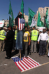 Palestinians walk on the U.S. flag during a demonstration against the controversial film 'Innocence of Muslims' in Khan Younis southern Gaza strip, on September 14, 2012. The controversial low budget film reportedly made by an Israeli-American which portrays Muslims as immoral and gratuitous, sparked fury in Libya, where four Americans including the ambassador were killed on Tuesday when a mob attacked the US consulate in Benghazi, and has led to protests outside US missions in Morocco, Sudan, Egypt, Tunisia and Yemen. Photo by Ashraf Amra
