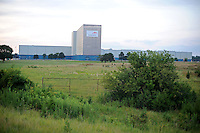 The Arcelor Mittal plant, which closed after several rounds of layoffs in between March 1-20, 2009, in Hennepin, Illinois on July 20, 2009.  The plant, owned by the largest steel company in the world, Mittal, had previously employed 280 hourly workers and an unknown salaried employees; an informational picket set up at both the main and west gates to the plant has claimed one major success, the refusal of a company to strip the plant and send the machinery offshore.