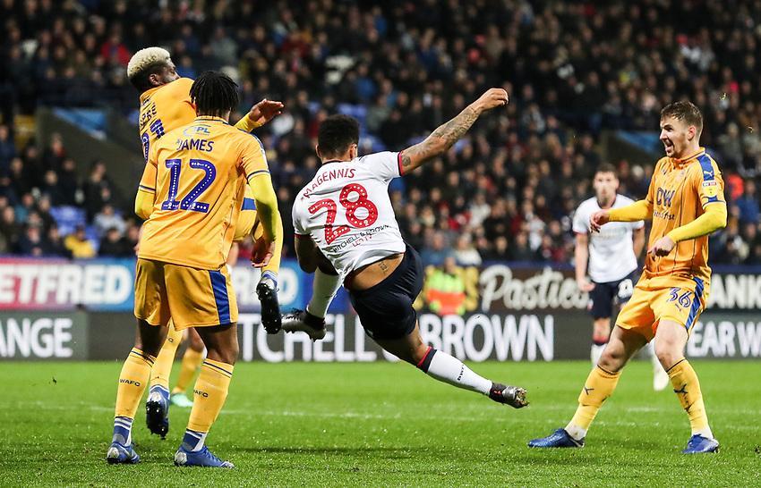 Bolton Wanderers' Josh Magennis shoots at goal <br /> <br /> Photographer Andrew Kearns/CameraSport<br /> <br /> The EFL Sky Bet Championship - Bolton Wanderers v Wigan Athletic - Saturday 1st December 2018 - University of Bolton Stadium - Bolton<br /> <br /> World Copyright © 2018 CameraSport. All rights reserved. 43 Linden Ave. Countesthorpe. Leicester. England. LE8 5PG - Tel: +44 (0) 116 277 4147 - admin@camerasport.com - www.camerasport.com