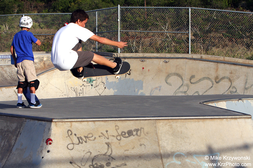 Young skateboarder Malachi Montes getting air the Banzai Skate Park, North Shore, Oahu, Hawaii