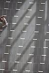 Student walks across tile floor on the campus of the University of Rhode Island. (Photo/Joe Giblin)