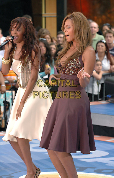 MICHELLE WILLIAMS & BEYONCE KNOWLES - DESTINY'S CHILD.Performing in concert at the NBC Today Show at Rockefeller Center in Manhattan, New York, New York..July 29th, 2005.Photo Credit: Patti Ouderkirk/AdMedia.full length singing stage concert live gig performance white brown purple dress playing air guitar gesture funny.www.capitalpictures.com.sales@capitalpictures.com.© Capital Pictures.