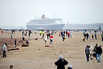 Cunard Line's Three Queens Meeting Liverpool. <br /> Crosby Beach 25.5.15. Queen Mary 2 viewed from Crosby Beach on the way to meet up with Queen Victoria and Queen Elizabeth.