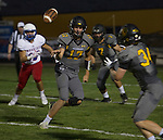 Galena quarterback Derek Kline pitches the ball to #34 Tanner Smith in their game against Reno played on Friday night Sept. 16, 2016 at Galena High School.