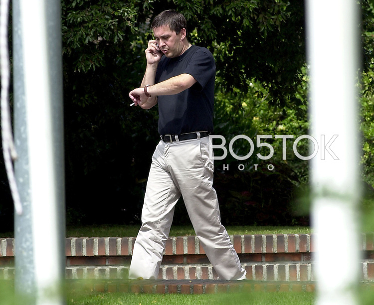 Batasuna Spokesman Arnaldo Otegi speaks on his cell phone after giving a press conference on August, 24th 2002 in the city of Donostia-San Sebastian, Basque Country. (Ander Gillenea / Bostok Photo)