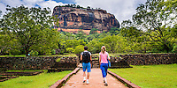 Panoramic photo of tourists in the Royal Gardens at Sigiriya Rock Fortress, aka Lion Rock, Sri Lanka. This is a panoramic photo of tourists in the Royal Gardens at Sigiriya Rock Fortress, aka Lion Rock, Sri Lanka. Sigiriya Rock is easily the most popular tourist attraction in Sri Lanka.