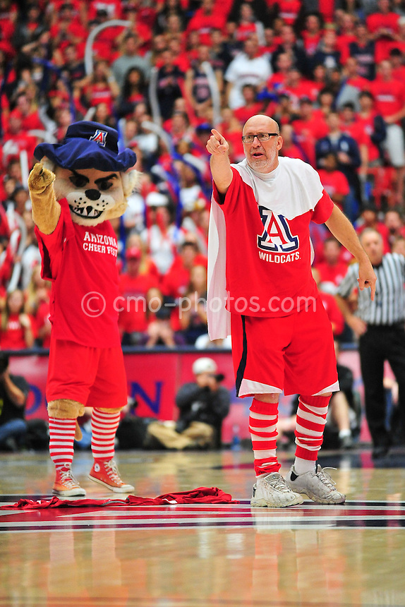 Jan 15, 2011; Tucson, AZ, USA; Joe Cavaleri, also known as The Ooh Aah Man, leads the McKale Center crowd in a cheer along with Wilbur, the Arizona Wildcats mascot, in the 2nd half of a game against the Arizona State Sun Devils.  The Wildcats won the game 80-69.