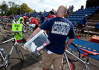 14 MAY 2010 - HOLME PIERREPONT, GBR - A competitor prepares to rack his bike before the start of the VUE National Emergency Services Triathlon Championships (PHOTO (C) NIGEL FARROW)
