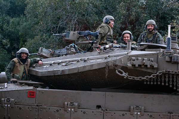 A picture taken on December 5, 2018, near the Israeli town of Zarit, shows an Israeli  soldiers atop of Israeli Merkava tank parked near the border with Lebanon, after the area was declared a closed military zone by the Israeli army. - Israel's army said earlier in the week that it has discovered Hezbollah tunnels infiltrating its territory from Lebanon and launched an operation to destroy them, a move likely to raise tensions with the Iran-backed group.Photo by: JINIPIX