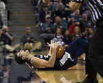 Utah State guard Diogo Brito (24) reacts after sliding out of bounds against Nevada in the second half of an NCAA college basketball game in Reno, Nev., Wednesday, Jan. 2, 2019. (AP Photo/Tom R. Smedes)