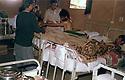Iran 1982 Hassan Shatavi in the hospital of KDPI  Iran 1982 Hassan Shatavi examinant un malade dans un hopital du PDKI