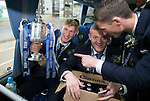 St Johnstone v Dundee United....17.05.14   William Hill Scottish Cup Final<br /> David Wotherspoon holds the trophy as Brian Eastonand Gary McDonald sort the beer on the journey back to Perth<br /> Picture by Graeme Hart.<br /> Copyright Perthshire Picture Agency<br /> Tel: 01738 623350  Mobile: 07990 594431