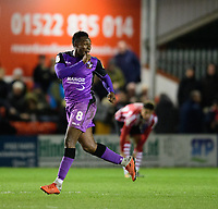 Port Vale's Emmanuel Oyeleke celebrates scoring his side's equalising goal to make the score 1-1<br /> <br /> Photographer Chris Vaughan/CameraSport<br /> <br /> The EFL Sky Bet League Two - Lincoln City v Port Vale - Tuesday 1st January 2019 - Sincil Bank - Lincoln<br /> <br /> World Copyright &copy; 2019 CameraSport. All rights reserved. 43 Linden Ave. Countesthorpe. Leicester. England. LE8 5PG - Tel: +44 (0) 116 277 4147 - admin@camerasport.com - www.camerasport.com