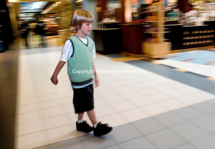 WATERBURY, CT- 14 JUNE 2007- 061407JT01-<br /> <br /> Ryan DeLello, 7, of Morris, rolls by on his Heelys in front of Stride Rite, a store that sells the shoe, at the Brass Mill Mall in Waterbury on Thursday. DeLello has been wearing the shoes, which have wheels in the soles, for about a year.<br /> Josalee Thrift Republican-American
