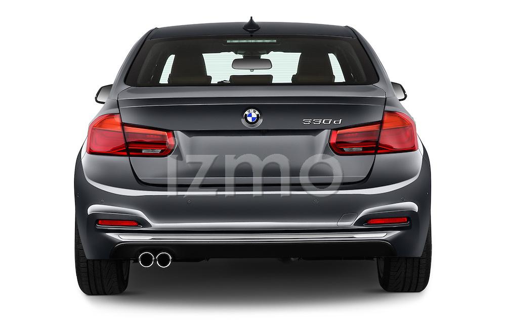 Straight rear view of 2016 BMW 3 Series Luxury 4 Door Sedan Rear View  stock images