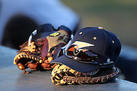 Akron Zips hat and glove sit on top of the dugout during a game vs the Michigan State Spartans at Chain of Lakes Park in Winter Haven, Florida;  March 12, 2011.  Michigan State defeated Akron 5-1.  Photo By Mike Janes/Four Seam Images