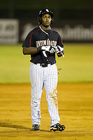 Courtney Hawkins (12) of the Kannapolis Intimidators takes off his batting gloves after having been stranded on base during the South Atlantic League game against the West Virginia Power at CMC-Northeast Stadium on August 17, 2012 in Kannapolis, North Carolina.  (Brian Westerholt/Four Seam Images)