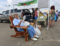 NWA Democrat-Gazette/FLIP PUTTHOFF<br /> APPRECIATED CUSTOMER<br /> Skeeter Armstrong (cq) of Springdale relaxes in a cedar chair she hopes to win Saturday Aug. 12 2017 during customer appreciation day at the Springdale Farmers Market at the Jones Center for Families. Customers received free seed packets, samples of vendor items and drawings for prizes, including the cedar chair built and donated by Jack Ledbetter, a market vendor. The market is open Tuesday, Thursday and Saturday from 7 a.m. to 1 p.m. at the Jones Center. Sarah and Javier were at the market with their mom, Jamie Widger of Springdale.