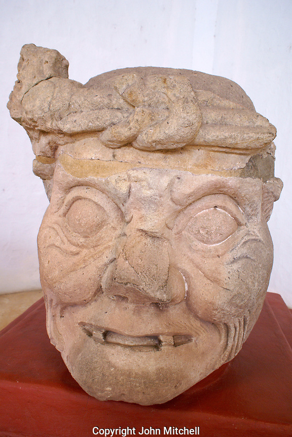 Maya Toothless Old Man of Copan or Pauahtun head from Temple 11, Copan Sculpture Museum, Copan, Honduras.