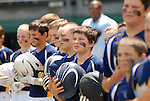 Little League baseball players greet each other as they are introduced before the game.