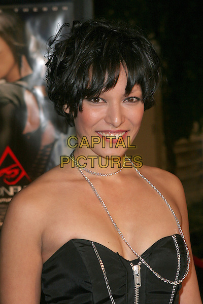"YANGZOM BRAUEN.Paramount Pictures' ""Aeon Flux"" premiere held at the Cinerama Dome, Los Angeles, California..December 1st, 2005.Photo: Zach Lipp/Admedia/Capital Pictures.Ref: ZL/ADM.headshot portrait strapless silver necklace chain .www.capitalpictures.com.sales@capitalpictures.com.© Capital Pictures."