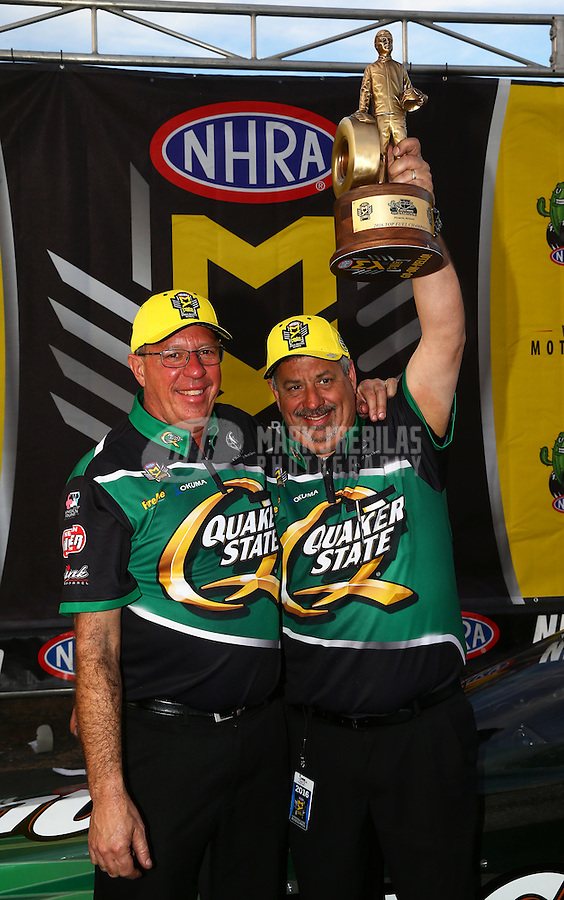 Feb 28, 2016; Chandler, AZ, USA; Co crew chiefs Mike Guger (left) and Joe Barlam for NHRA top fuel driver Leah Pritchett (not pictured) celebrate after winning the Carquest Nationals at Wild Horse Pass Motorsports Park. Mandatory Credit: Mark J. Rebilas-