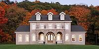 Traditional dusk exterior with arched cut stone porch and arched windows..