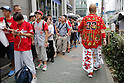 Hiroshima Carp baseball team fans line up near to Hiroshima Brand Shop TAU in Ginza on September 11, 2016, Tokyo, Japan. Hundreds of Carps fans lined up from early morning outside Hiroshima Brand Shop TAU to buy victory t-shirts after Hiroshima baseball team got its first Central League title in 25 years after beating the Yomiuri Giants 6-4 on Saturday, September 10. (Photo by Rodrigo Reyes Marin/AFLO)