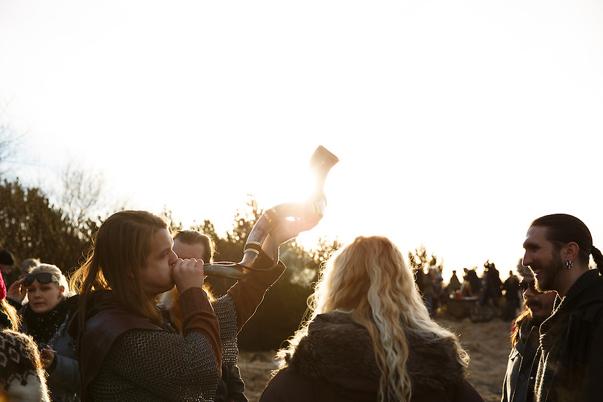 Members of the neo-pagan Asatru association blowing horns and watching the solar eclipse in Reykjavik, Iceland.