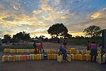 People line up jerry cans before dawn in the Rhino Refugee Camp in northern Uganda. As of April 2017, the camp held almost 87,000 refugees from South Sudan, and more people were arriving daily. About 1.8 million people have fled South Sudan since civil war broke out there at the end of 2013. About 900,000 have sought refuge in Uganda. <br /> <br /> Because water pumps in the camp are solar-powered, water can only be obtained during daylight hours. Refugees will therefore line up their jerry cans overnight in order to be among the first to get water in the morning.<br /> <br /> The Global Health Program of the United Methodist Church has supported work to improve access to safe drinking water in the camp.