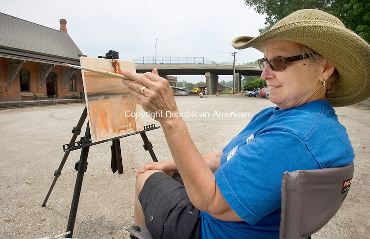 THOMASTON CT. 11 June 2015-061115SV08-Judy Kontout of Watertown paints a picture of the train station in Thomaston Thursday. A group of artists spent the afternoon painting outside the train station.<br /> Steven Valenti Republican-American