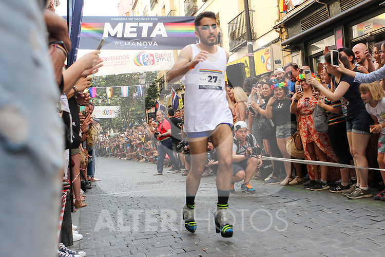 A participant runs during a high-heel race as part of Gay Pride month in the neighbourhood of Chueca on July 4, 2019.on July 04, 2019 in Madrid, Spain.(ALTERPHOTOS/ItahisaHernadez)