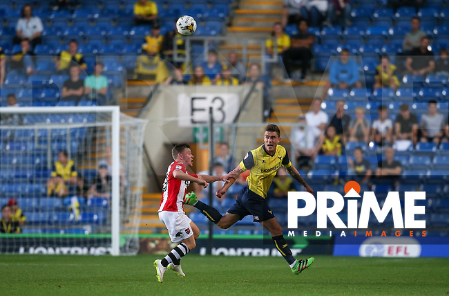 Josh Ruffels of Oxford United clears the ball as he plays his 100th appearance for the club during the The Checkatrade Trophy match between Oxford United and Exeter City at the Kassam Stadium, Oxford, England on 30 August 2016. Photo by Andy Rowland / PRiME Media Images.