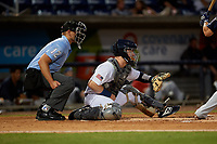 Umpire Brock Ballou and Pensacola Blue Wahoos catcher Ryan Jeffers (8) await the pitch during a Southern League game against the Mobile BayBears on July 25, 2019 at Hank Aaron Stadium in Pensacola, Florida.  Pensacola defeated Mobile 3-2 in the second game of a doubleheader.  (Mike Janes/Four Seam Images)