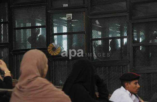 Suspects of Ansar Bait Al-Maqdis group, attend their trial in Cairo on Oct. 13, 2015, on charges of assassination of police officers, attempted assassination of interior minister Mohamed Ibrahim and explosions near security facilities to July 4. Photo by Amr Sayed