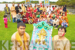 Prasanta Chakravarty and Sanjib Kumar Das Killarney and the Killarney Hindu Cultural organisation with the statue of Goddess Durga which they placed into the Lakes of Killarney to celebrate the Durga Puja festival in Ross Castle on Monday