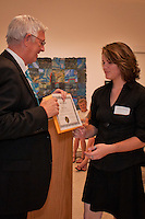 Katherine Navarro accepts her award as the Naples Art Association at The von Liebig Art Center and Ringling College of Art and Design awarded $8,000 in college scholarships to seven Collier County high school juniors and seniors on Friday, April 15, 2011. Photo by Debi Pittman Wilkey