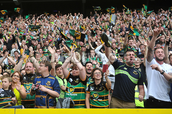 Northampton Saints fans in the crowd celebrate. Aviva Premiership Final, between Saracens and Northampton Saints on May 31, 2014 at Twickenham Stadium in London, England. Photo by: Patrick Khachfe / JMP