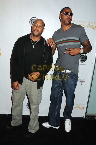 "Finesse Mitchell and Kenyon Martin.Kevin Hart's ""Laugh At My Pain"" Los Angeles Premiere held at the Pacific Design Center, West Hollywood, California, USA..September 7th, 2011.full length grey gray top sunglasses shades jeans denim black.CAP/ADM/BP.©Byron Purvis/AdMedia/Capital Pictures."