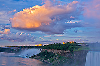 Storm clouds at sunrise with fog as The Niagara River plunges over Niagara Falls.  Golden Horseshoe. Niagara Peninsula.<br /><br />Ontario<br />Canada