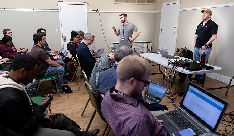 Rudy Ristich, adjunct faculty of Security, Game Development, and Internet of Things, left, and Jayson Margalus, instructor of Game Development, Hardware, and Tactile Internet, both in the College of Computing and Digital Media, present a workshop during the 2019 Thotcon hacking and information security conference, Friday, May 3, 2019. (DePaul University/Jeff Carrion)